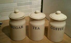 Cream ceramic tea coffee and sugar containers