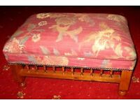 Large upholstered country house style footstool can be used as coffee table.