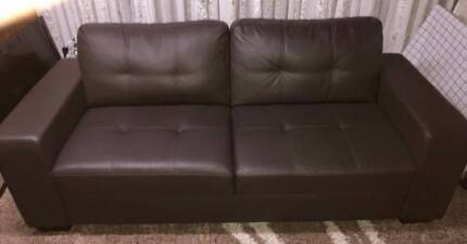 Chocolate Brown 3 seater lounge in like new condition.