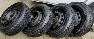 One set of 4 winter tires with rims P175/65R14 for Ho