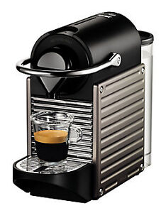 Nespresso Pixie machine and 7 different sleeves of coffee