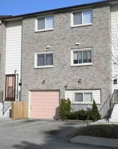 4 bdrm townhouse with a den near UWO.   Available September 1st