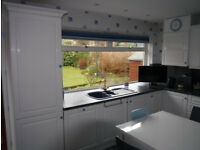 Fitted Gloss White Kitchen, 36 cabinets and drawer units, over 11m of worktops.