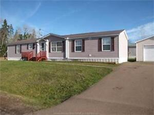 PRICED FOR QUICK SALE MINI HOME with large attached GARAGE