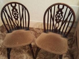 Pair of Solid Dark Oak upholstered seat wheel-back dining chairs.
