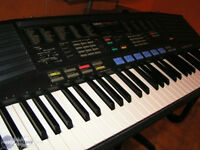 Yamaha PSR 47 Keyboard In EC with stand