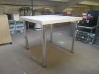 Display table with metal chromed legs, white top, business display, legs unscrew, office ?