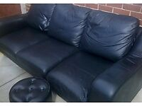 Quality black leather 3 piece suite/ also footstool/ no wear just one small tear at back of sofa