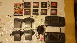 Two vintage Sega Game Gear consoles and extras