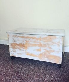 Vintage shabby chic trunk with wheels
