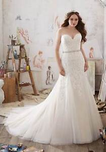Beautiful NEW wedding dresses, alterations available!