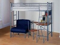 Childs metal bunk bed with futon and desk underneath.