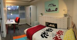 Newly renovated room/house, 20min SkyTrain ride to D/Town.