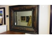 Decorative mirror in simulated leather finish