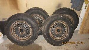 Snow tires 2 to 3 seasons left P215/ 70/r15 Off Pontiac Montana