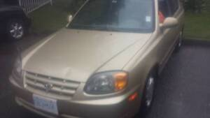 2005 Hyundai Accent moving must sale 1.6 L vry cheap on gas