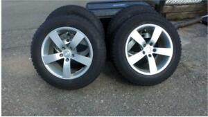 Snow tires mounted on alloy rims.