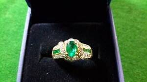 Here is a beautiful 18K Emerald ring nestled between gorgeous di