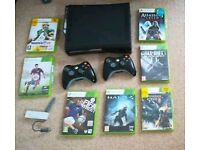 Xbox 360 Bundle with 2 controllers and 7 games including Call of Duty Black Ops 2 and Halo 4