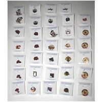 Lot of 34 NHL Team collector pins from the early 90's Box-5