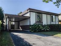 Maison jolie 199 900$ Laval avec abris d'auto
