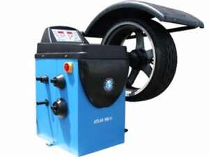 Electronic wheel balancer and tire changer