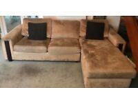 Corner sofa bed with footstool