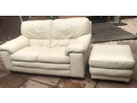 Cream leather two seater sofa and footstool