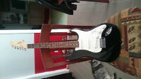Guitare Fender Stratocaster Squier - 1 ans d'usure