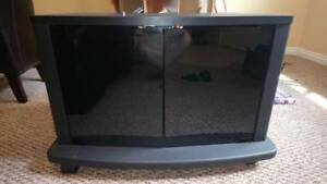 Entertainment/TV stand with doors/shelf and wheels