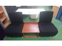 Large black armless cushioned chairs