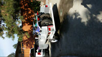 2 TW200 Yamaha trail bikes and trailer