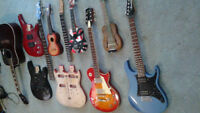 various guitars, guitar bodys necks and ukulele's