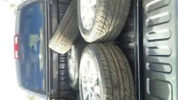 Brand new OEM Toyota wheels and tires.