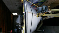 16 foot Fibreglass Boat Motor and Trailer with 25 horse Evinrude