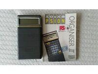 Psion organiser II with pocket spreadsheet program pack and spreadhseet manual