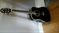 Barely used 1/4 size Oscar Schmidt guitar with carry case