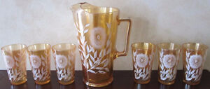 Iridescent Carnival Glass Pitcher and Six Glasses