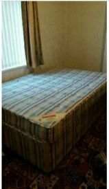 1 double divan bed with mattress with storage only £20 with head board if needed