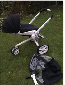 White and black quinny with newborn insert and raincover buggy/pram/stroller/pushchair