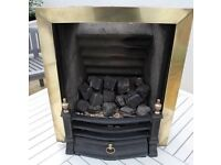 Open gas fire and mahogany surround