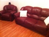 Burgundy real Leather 3 Seater plus sofa chair in very nice condition price to sell is ��350