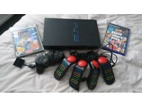 PlayStation 2 with games and Buzz controllers