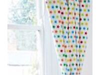 Colourful star blackout curtains and matching storage boxes
