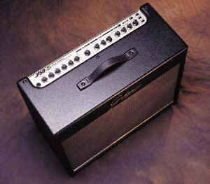 Black amp with round speaker, knobs and floor thingy - Trades?