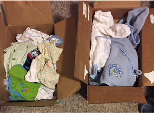 2 boxes with sleepers, swaddlers, sleep sacs.