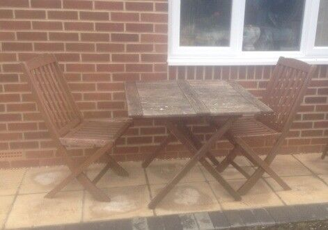 Folding garden table and two chairs