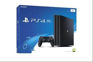 PlayStation 4 pro 2manette 2 jeux échange ou 550$