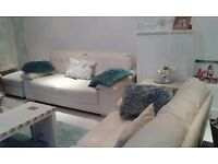 Two Large Cream Leather Sofas & matching Footstool