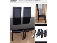 Harveys black glass extending table with 6 chairs